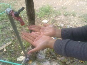 Liquid black soap was then rinsed with clean water and a hand that has been given a dirt stains from the dried ink and charcoal pans had to be clean.