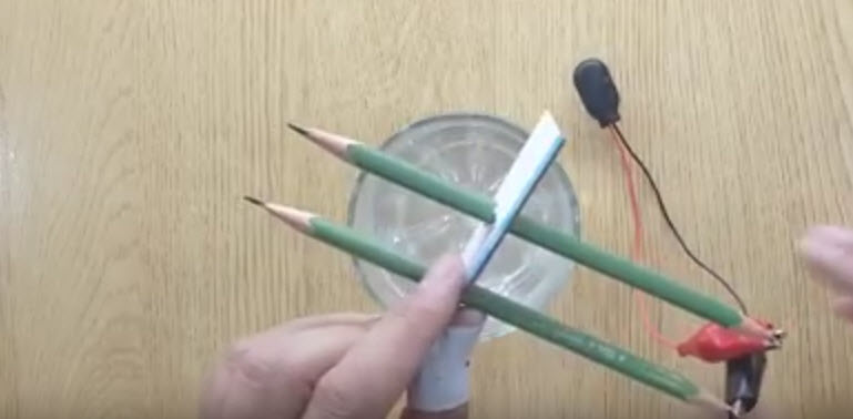 Put two pencils into cardboard, about one inchi apart.