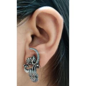 Tiny antique small Silver look alike earring