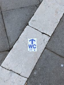 WC arrow on the ground in Piazza San Marco in Venice.