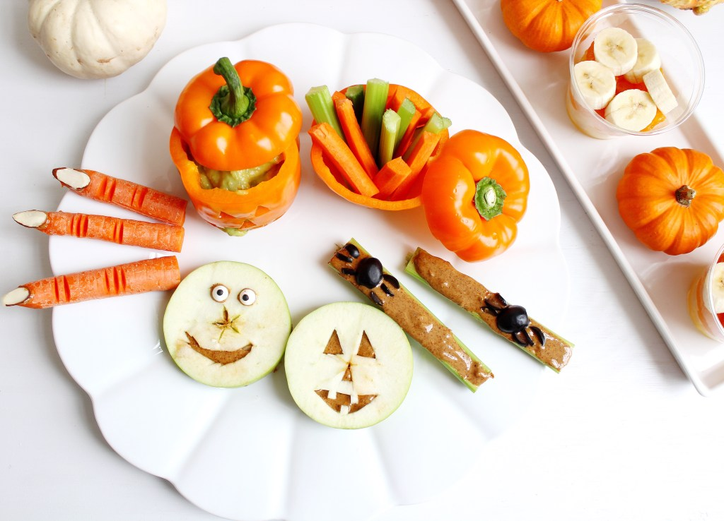 Platter of Whole 30 Halloween treats and pumpkins