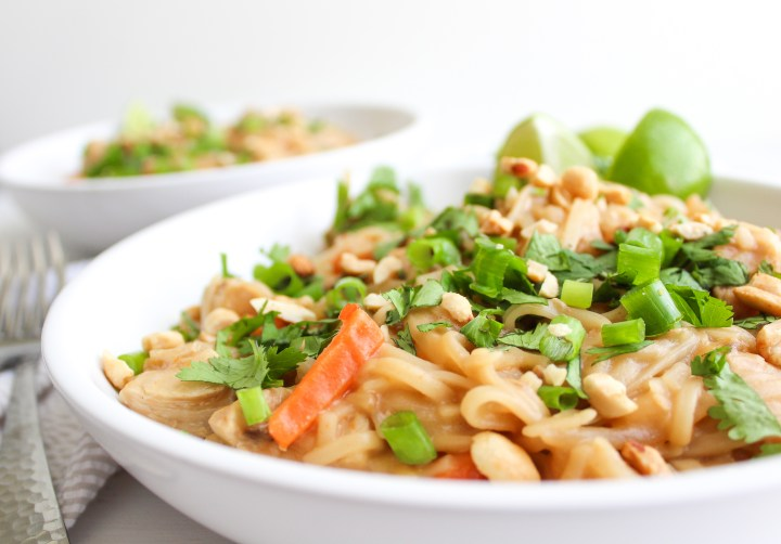 bowl with instant pot pad Thai noodles topped with cilantro and lime