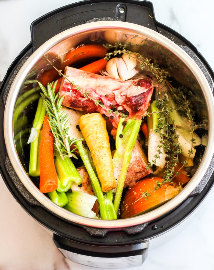 Instant Pot filled with bone broth ingredients