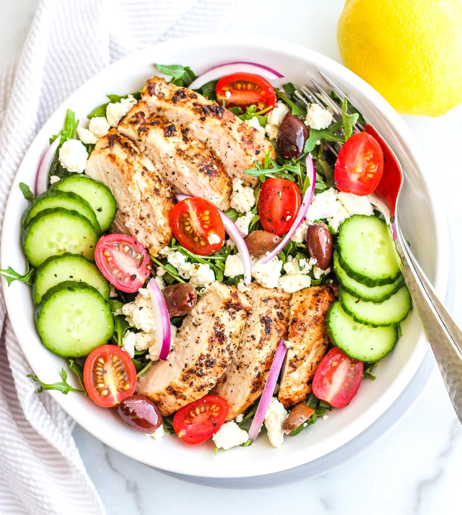 Greek Chicken Salad in a large white bowl