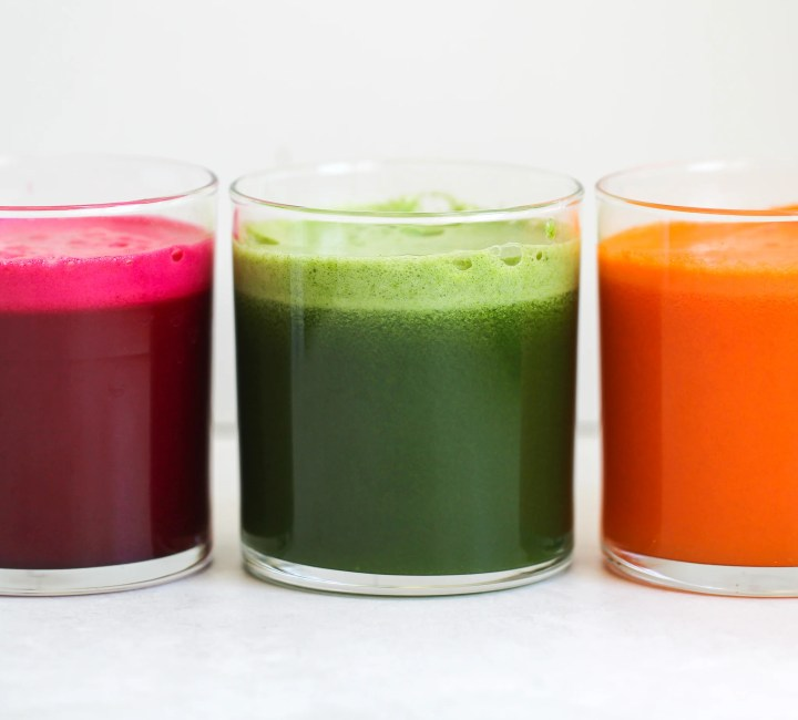 3 glasses of immune boosting juices lined up in a row - they are vibrant red, green and orange