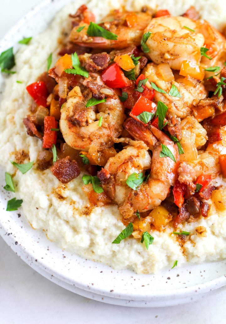 creole shrimp over 'cheesy' cauliflower grits and topped with fresh chopped parsley