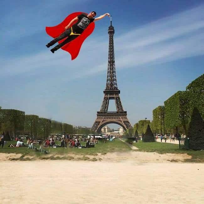 Superman's finger touches Eiffel tower