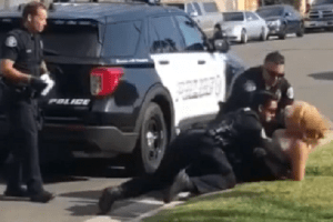 Westminster Police Officer Punches Handcuffed Woman
