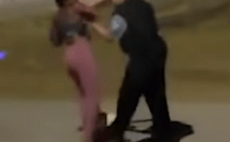 An unidentified Chicago police officer assaulted a Black woman for no apparent reason.