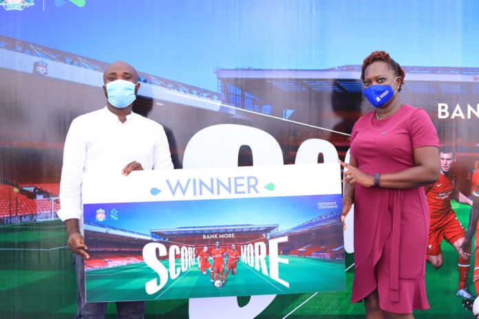 """StanChart presents prize to winner of """"Bank More Score More Campaign"""""""