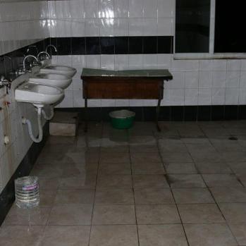 Another washroom, equally damp and dirty.