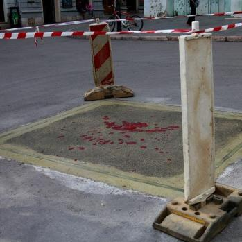 One of the many 'Sarajevo roses' throughout the city: mortar explosion marks filled with red resin to mark where one or more people died. The explosions occurred during the Siege of Sarajevo by the Army of Republika Srpska, from 5 April 1992 to 29 February 1996. It was the longest siege of a capital city in the history of modern warfare.