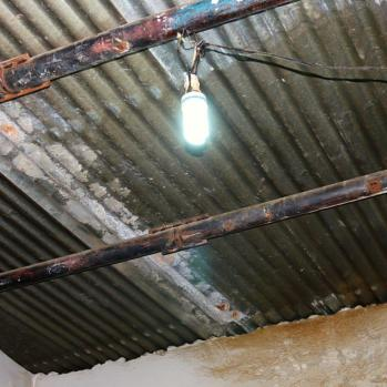 Their leaking roof, filled with asbestos.