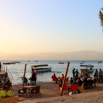 Aqaba! Just five days after leaving Amman, in a bid to make my rendez-vous with P in Dahab tomorrow. A true rumpus of a bummel. Finally find the tourist office to buy a ferry ticket after three hours of searching. The boat may go at 2pm, as planned, or may go at 5pm, or not at all, I am told. 'It's as the wind.'