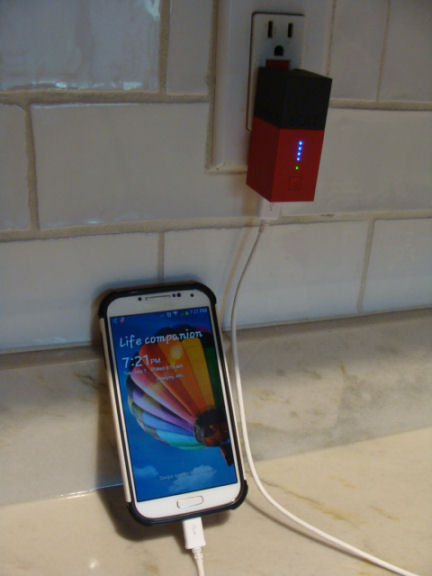charge your devices while it is plugged into the wall