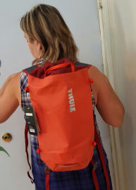 Thule Stir 15L orange hiking backpack