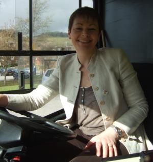Caroline Lucas MP behind the wheel of a Big Lemon bus