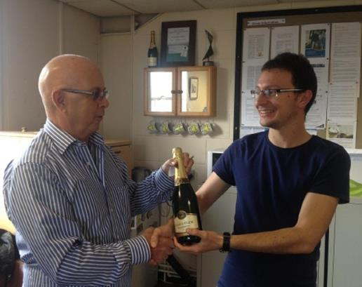 Riccardo presenting Bernard with his bottle of bubbly