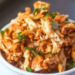 Stovetop Pulled Tandoori Chicken- Moist, flavourful and juicy pulled chicken made over the stovetop and ready in 20 MINUTES- No need for a slow cooker! Paleo, Gluten Free, Dairy Free and Whole30 friendly! @thebigmansworld.com - thebigmansworld.com