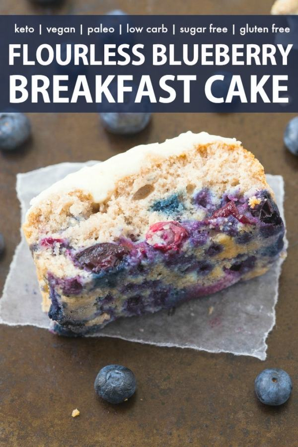 A slice of blueberry breakfast cake loaded with blueberries and topped with a thick, protein-rich frosting.