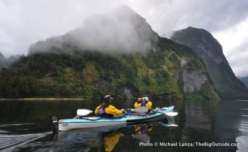 Sea kayakers in Hall Arm, Doubtful Sound, Fiordland National Park, New Zealand.