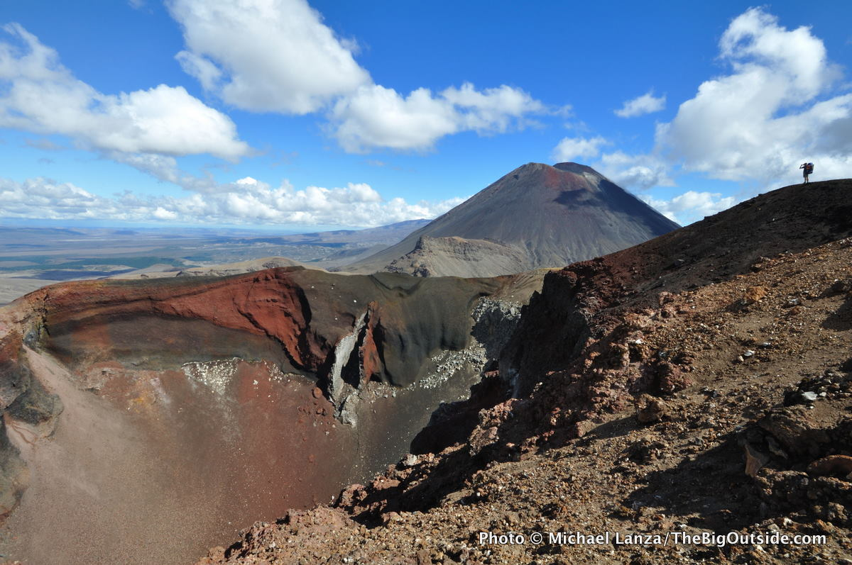 A hiker at the rim of Red Crater in New Zealand's Tongariro National Park.