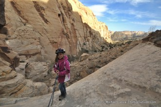 Alex rappelling out of Stegasaur Canyon.
