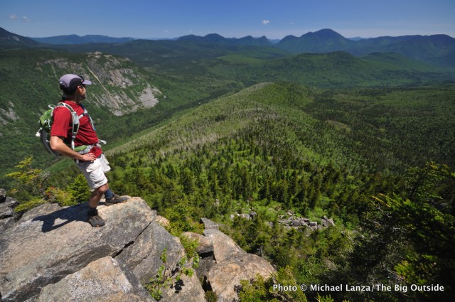 A hiker takes in the view from the Zeacliff Trail, White Mountains, N.H.
