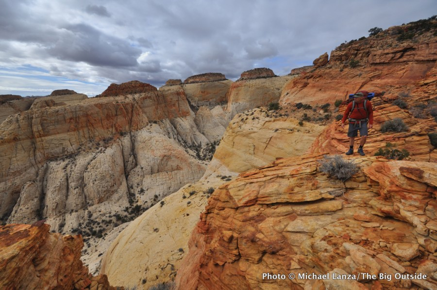 A backpacker on the off-trail Beehive Traverse in Capitol Reef National Park.