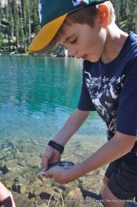 Fishing at Lake 8522, Sawtooth Mountains, Idaho.