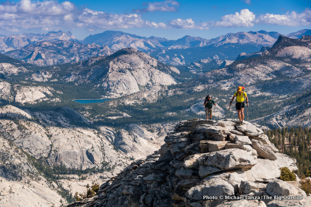 Backpackers on the summit ridge of Clouds Rest in Yosemite.
