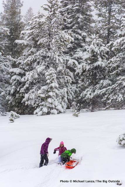 Sledding outside Banner Ridge yurt.