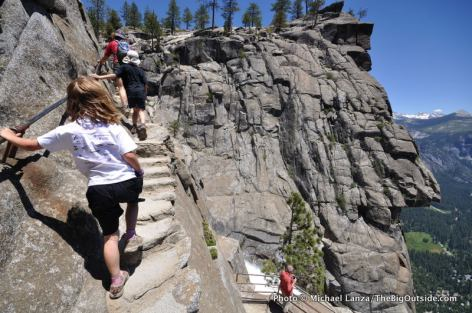 A family hiking the Upper Yosemite Falls Trail in Yosemite Valley.