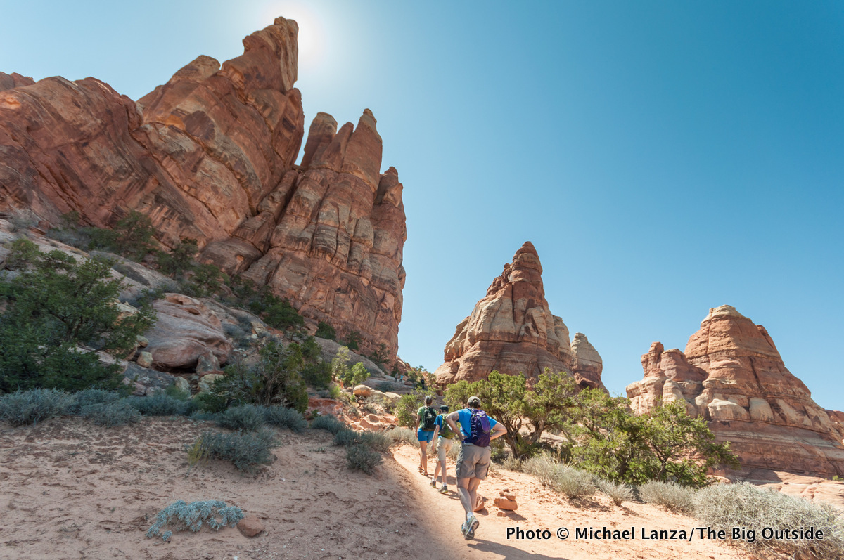 Hikers on the Chesler Park Trail, Needles District, Canyonlands National Park, Utah.