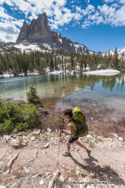 A backpacker hiking below El Capitan in Idaho's Sawtooth Mountains.