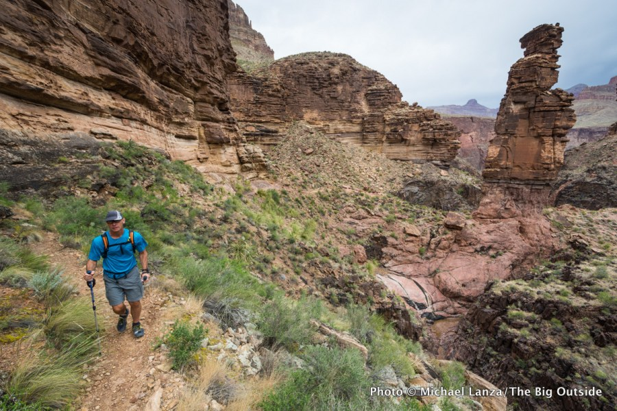 A hiker on the Tonto Trail by Monument Creek in the Grand Canyon.