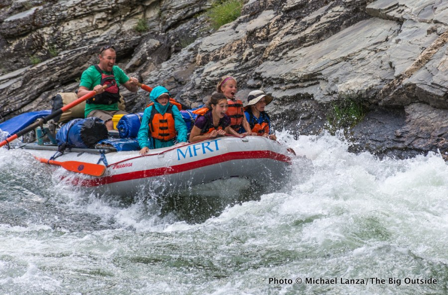 A raft filled with children running Cliffside Rapid on Idaho's Middle Fork Salmon River.