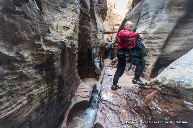 A hiker in The Subway, Zion National Park.