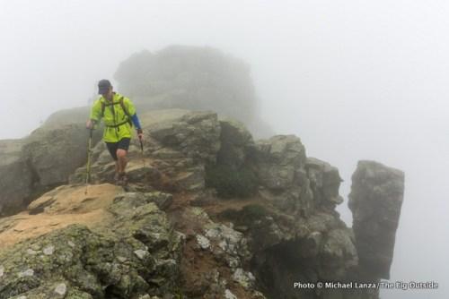 David Ports hikes through the fog on New Hampshire's Franconia Ridge.