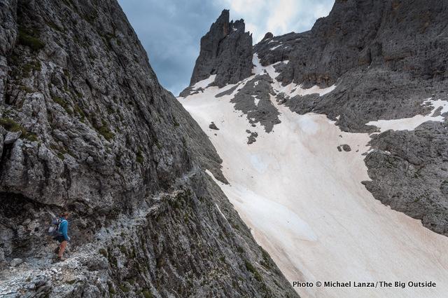 A hiker on the Alta Via 2 in Parco Naturale Paneveggio Pale di San Martino, Dolomite Mountains, Italy.
