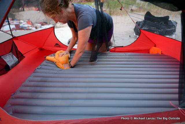 My wife, Penny, inflating the Exped SynMat Hyperlite Duo air mattress.