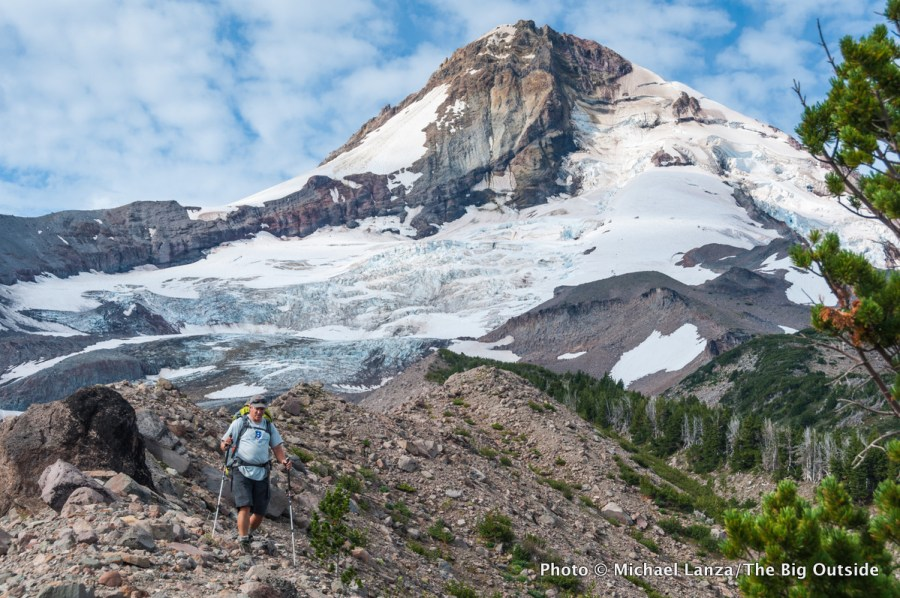 A backpacker hiking the Timberline Trail around Oregon's Mount Hood.