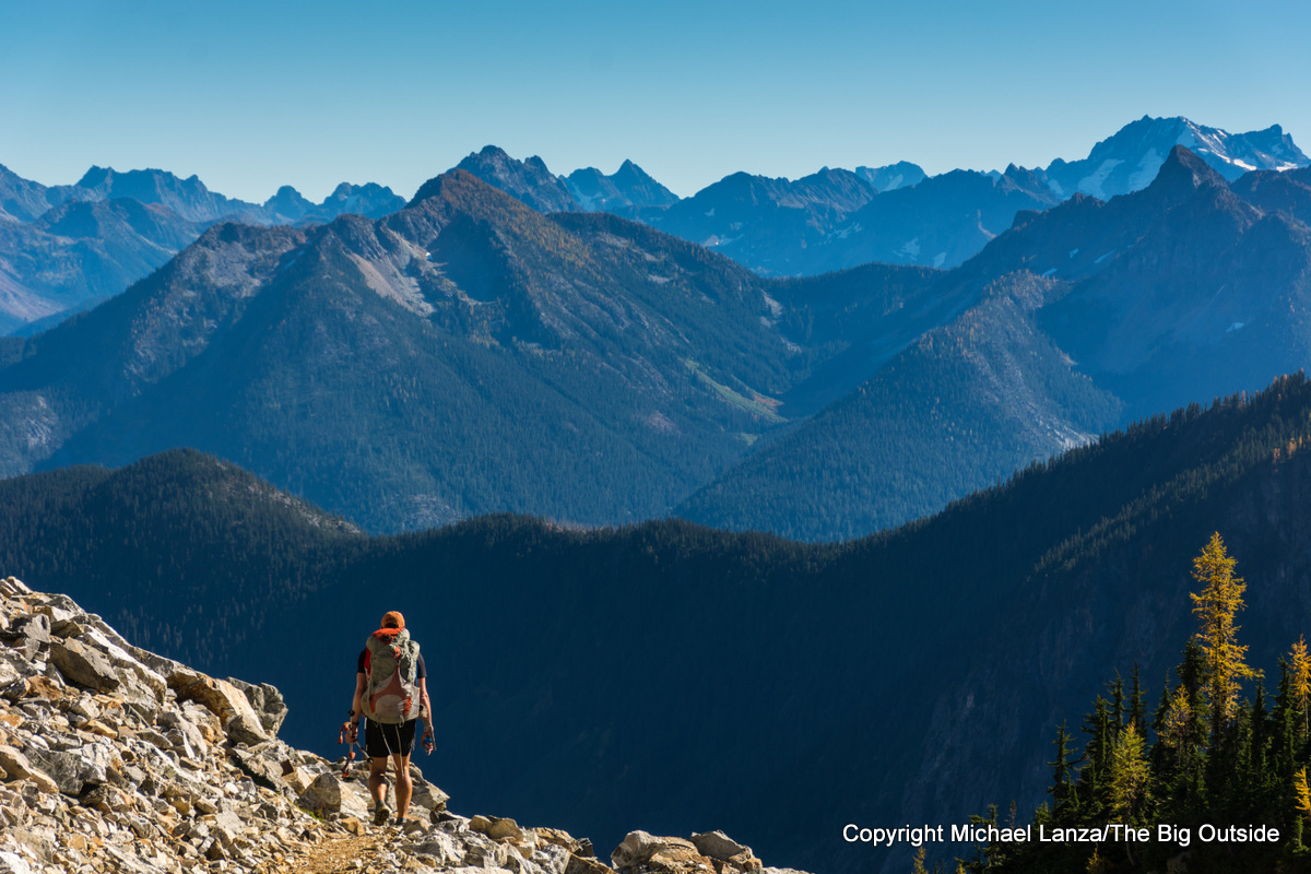 A backpacker hiking over Park Creek Pass in North Cascades National Park.