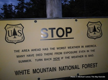 Weather warning sign on trail.
