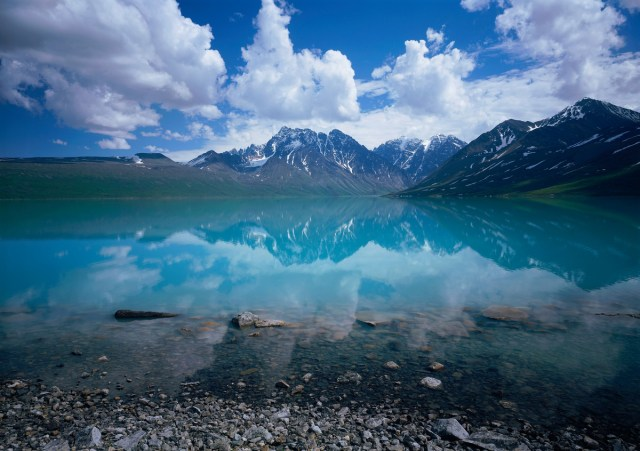 Clouds and Telaquana Mountains above Turquoise Lake, Lake Clark National Park, Alaska.