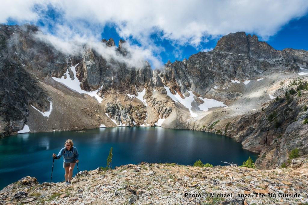 A hiker at Goat Lake below Thompson Peak, Sawtooth Mountains, Idaho.