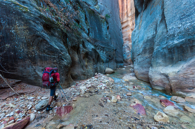 A backpacker in Zion's Narrows.