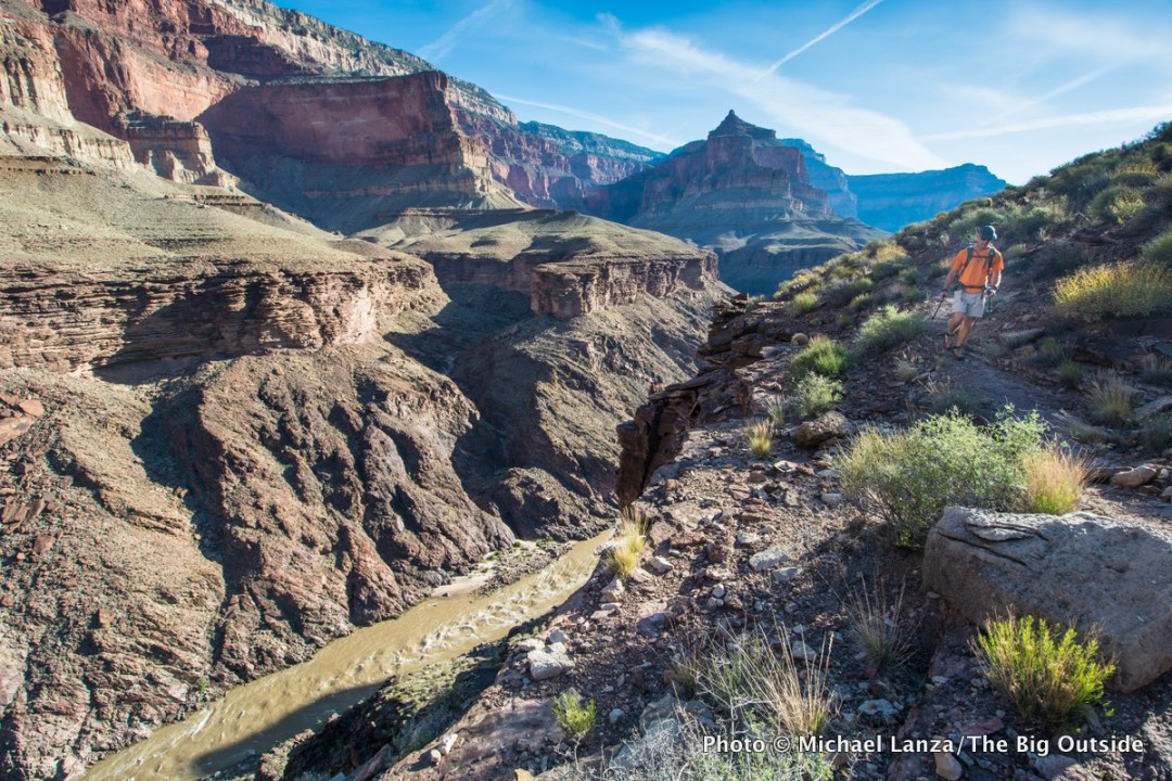 A backpacker on the Tonto Trail on the Grand Canyon's Royal Arch Loop.