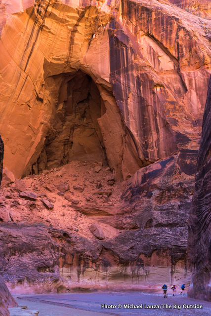Backpackers in the narrows of Paria Canyon.
