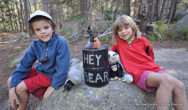 School-age kids at a campsite in Wild Basin, on a backpacking trip in Rocky Mountain National Park.